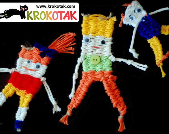 Woven toys on a piece of cardboard paper