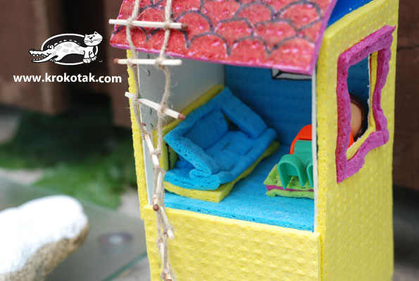 DIY house for toys from an empty milk box